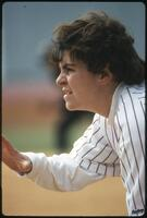 An Augsburg women's softball team player in action, circa 1985.