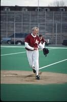 An Augsburg women's softball team pitcher throws the ball, 1995.