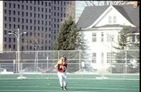 An Augsburg women's softball team outfield player in action, 1994.
