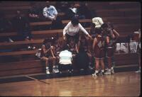 Augsburg women's basketball team players in a huddle during a timeout, 1993.
