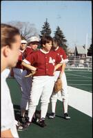 Augsburg women's softball team players on the sidelines, 1995.