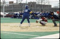 An Augsburg women's softball team catcher in action during a game, 1994.