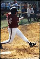 An Augsburg women's softball team batter attempts a hit, 1995.