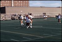 An Augsburg women's soccer team player tackles a player, 1997.