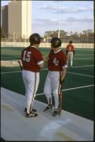 Augsburg women's softball team players talk before a game, 1997.