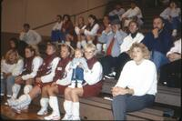 Augsburg women's volleyball team players on the bench, circa 1985.