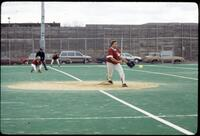 An Augsburg women's softball team pitcher pitches in a game, 1994.