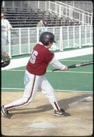 An Augsburg women's softball team batter swings at a ball, 1995.