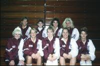 Augsburg women's volleyball team players take a team photo, circa 1985.