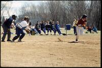 An Augsburg women's softball team batter runs to a base after a hit, 1994.