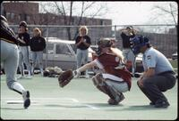 An Augsburg women's softball team catcher in action, 1994.