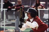 An Augsburg women's softball team batter gets ready to hit a ball, 1997.
