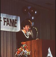 An Augsburg women's softball team coach gets recognized, circa 1985.