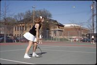 An Augsburg women's tennis player plays in a match, 1997.