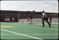 Augsburg women's softball team players in action, 1995.