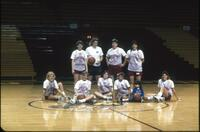 Augsburg women's basketball team players take a team photo, 1997.