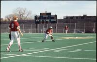 Augsburg women's softball team outfield players in action, 1994.