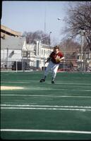 An Augsburg women's softball team outfield player in a action, 1995.