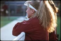 Augsburg women's softball team players on the bench watch their teammates, 1995.