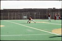 An Augsburg women's softball team outfield player during a game, 1994.