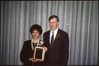 An Augsburg women's softball team coach receives an award, circa 1985.