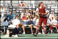 An Augsburg women's softball team player plays in a game, circa 1990.