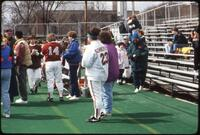Augsburg women's softball team players with friend and family after a game, 1994.