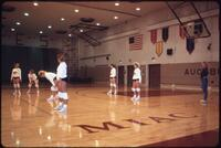 Augsburg women's volleyball team players play in a match, circa 1985.