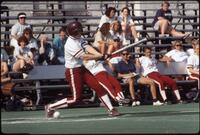 An Augsburg women's softball team batter hits a ball, circa 1990.