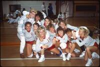 Augsburg women's volleyball team players take a group picture, circa 1985.