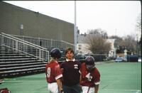An Augsburg women's softball team coach talks to her players, 1993.