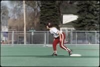 An Augsburg women's softball team player runs to a base, 1997.