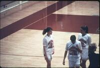 Augsburg women's basketball team players on the bench during a game, 1993.