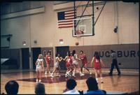 Augsburg women's basketball team players play in a game, circa 1985.