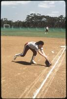 An Augsburg women's softball team player in a game, circa 1985.