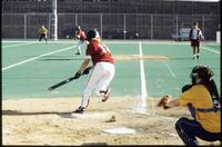 An Augsburg women's softball team batter hits a ball, 1995.
