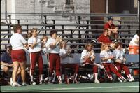 An Augsburg women's softball team bench during a game, circa 1990.