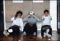 Three students sitting on the ground, circa 1990