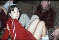 An Augsburg women's athlete looking at the camera while sitting on the ground, circa 1975.