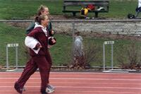 Two Augsburg women's track and field team runners running together, circa 2000