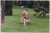 Two Augsburg women's cross country team runners running beside each other, 2002