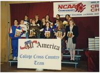 Augsburg women's cross country team runner holding an award at the 1995 NCAA Championships, 1995