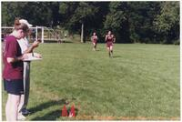 Two Augsburg men's cross country team runners during a race, 2002