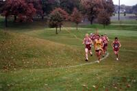 Augsburg men's cross country team runners running, 2002