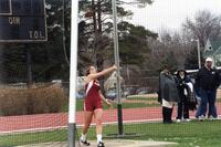 Augsburg women's track and field team player doing the shot put, circa 2000
