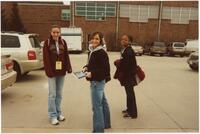 Augsburg women's track and field or cross country team runners standing outside, circa 2000
