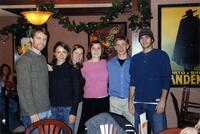 Augsburg women's and men's cross country team runners taking a photo together in a restaurant, circa 2000