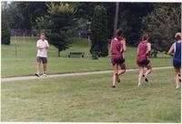 Augsburg women's cross country team coach claps his hands, circa 1996