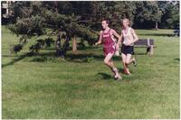 Augsburg men's cross country team runner running, 2002