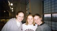 Augsburg women's track and field team runners taking a photo together, circa 2000